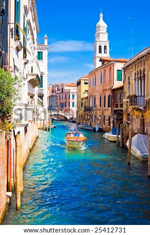 A motor boat in beautiful canal, Venice, Italy - stock photo