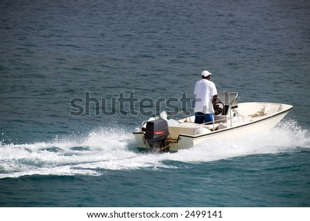 A motorboat in the Caribbean. - stock photo