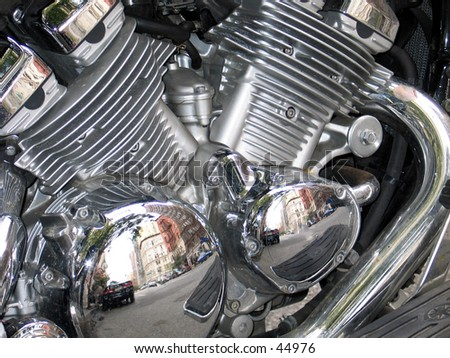 A motorcycle engine, chrome - stock photo