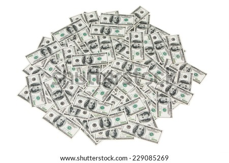 A mound of loose bills, isolated on white. - stock photo