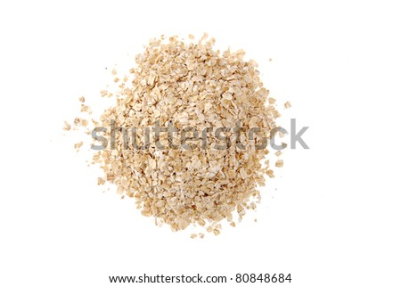 A mound of rolled oats on a white background