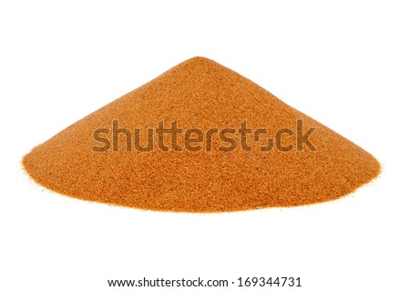 a mound of sand on a white background - stock photo