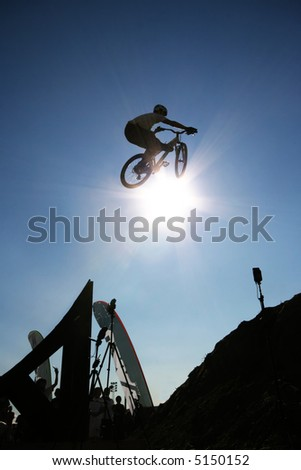 A mountain biker flies through the air in Norway. - stock photo