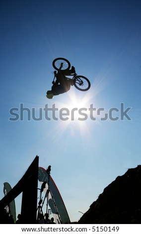 A mountain biker in mid-flip during a contest in Norway. - stock photo