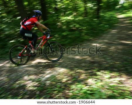 a mountain biker on a turn - stock photo