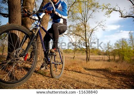 A mountain biker riding through a trail - stock photo