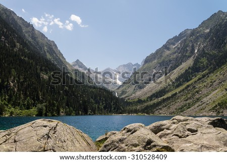 A mountain lake at the French Pyrenees. - stock photo