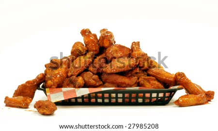 A mountain of Chicken Wings on a tray. - stock photo