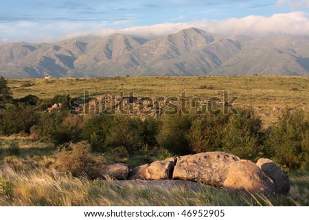 A mountain range famous for its mythical properties and multiple UFO sightings as seen from La Cumbre in Argentina. - stock photo