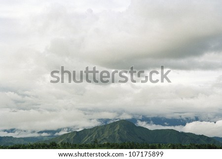 A mountain scenery under a cloudy sky, Papua New Guinea.