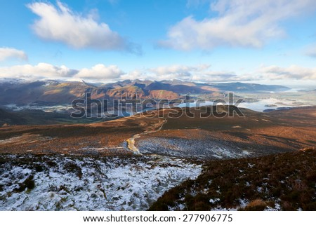 A mountain trail looking out across the Derwent Fells near Keswick in the English Lake District, Cumbria, England. UK. - stock photo