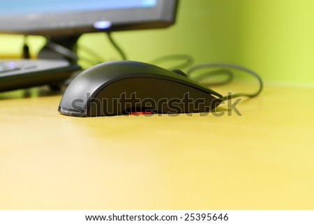 a mouse with computer on a table - stock photo