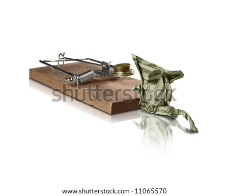 A mousetrap attracting an origami Mouse. Can be used as a concept for attracting wealth for smart investing, or risky investing. - stock photo