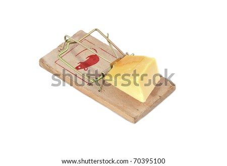 A mousetrap with cheese as bait. - stock photo