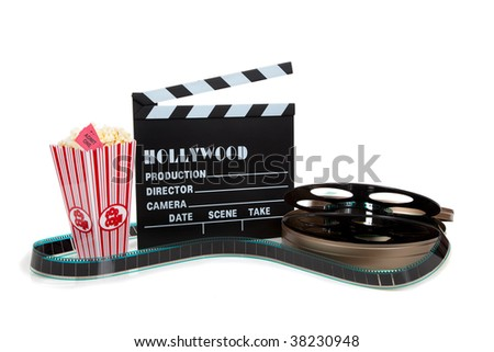 A movie reel with clapboard and popcorn on a white background - stock photo