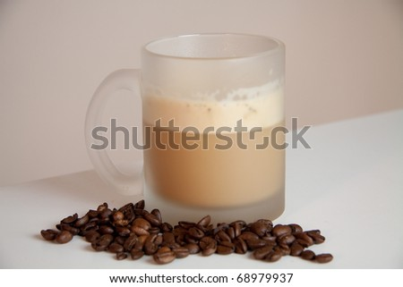 A mug of coffee on a white table