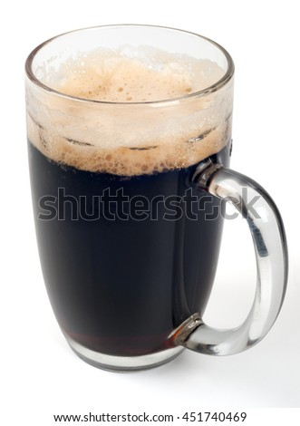 A mug of dark beer - stock photo