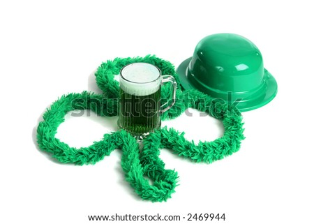 A mug of green beer with an Irish bowler hat and a green boa in the shape of a shamrock.  White background. - stock photo