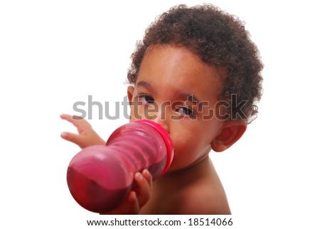 A multi-racial baby boy drinking. - stock photo