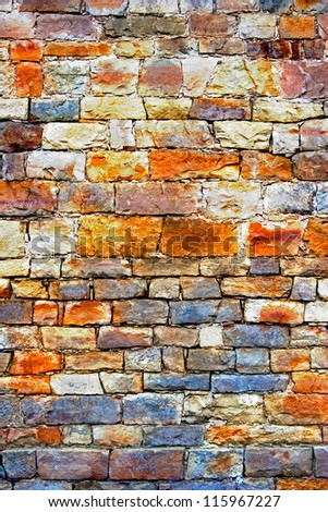 A multicolored stone and rough wall