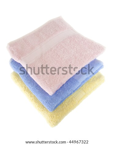 a multicolored towels stacked isolated - stock photo