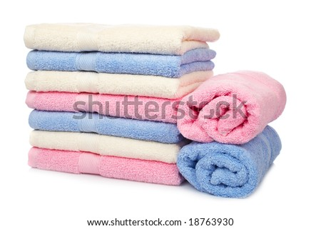 A multicolored towels stacked with soft shadow on white background - stock photo