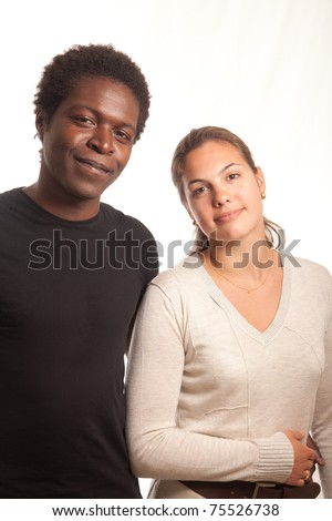a multiracial couple posing together for the camera - stock photo