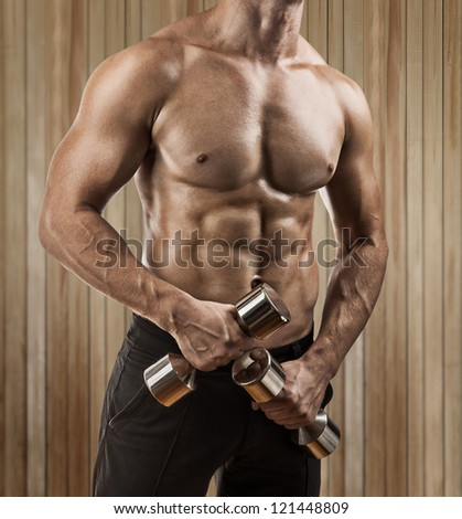 a muscular male torso close up - stock photo