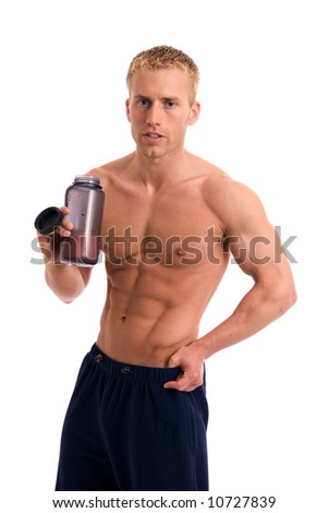 A muscular man drinking a protein drink - stock photo