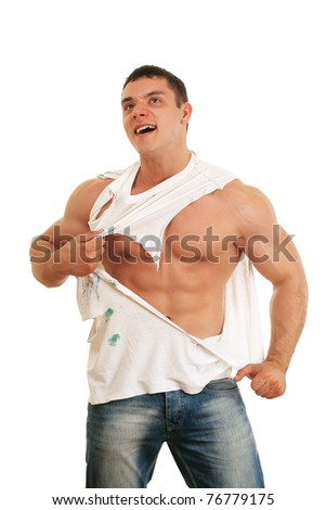 A muscular man tearing his t-shirt