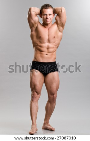a muscular young man posing - abs