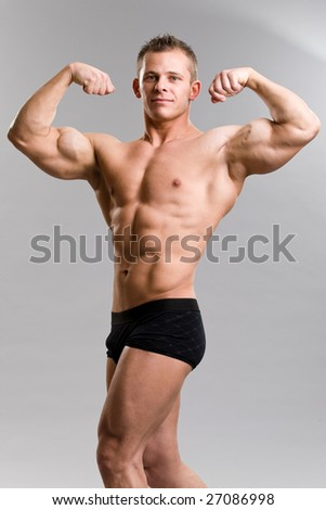 a muscular young man posing - double biceps