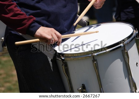 A  musician drummer playing their drums