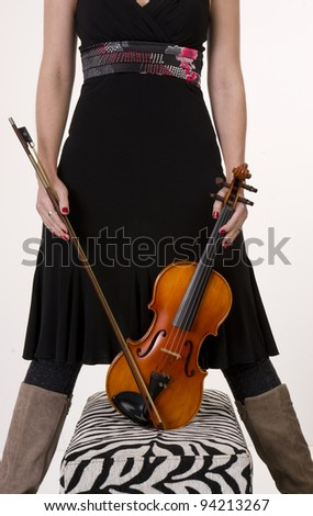 A musician hols her Bow and Violin - stock photo