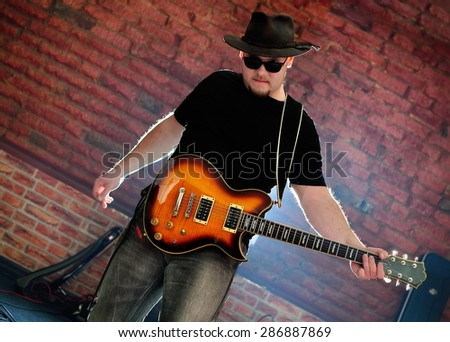 A musician play on guitar. Members of �«Kabanas band�» group. Rostov-on-Don - stock photo