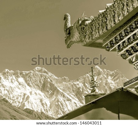 A mythical dragon guards the gate of the Tengboche Monastery - Everest region, Nepal, Himalayas (stylized retro) - stock photo