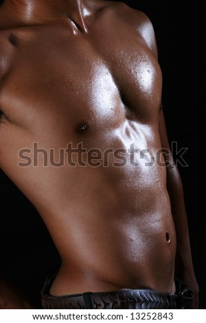 A naked young asian muscle hunk bending his curvy body - stock photo