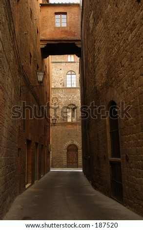 A narrow alley between two buildings`, Siena, Tuscany, Italy,