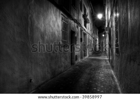 A Narrow European Street at Night in Black and White