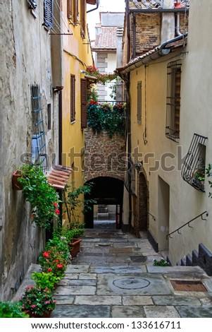 A narrow lane in Montepulciano - stock photo