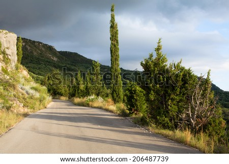 A narrow mountain road, on the island of Lefkada (Greece) - stock photo