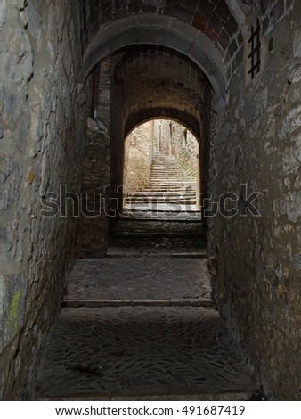 "A narrow passage in the medieval ""calle"" or Jewish quarter of Girona, Spain"
