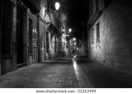 A Narrow Street at Night in Europe - stock photo