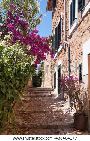 A narrow street in the center of Fornalutx which is a mountainous municipality and village on Mallorca and one of the most attractive villages on the west coast