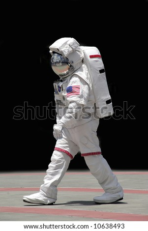 A NASA astronaut, earth reflected in his helmet - stock photo