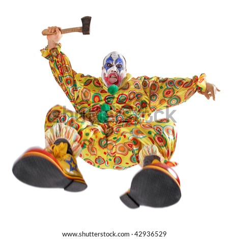 A nasty evil clown, angry, jumping, and about to hack you to bits.  Motion blur on the knees and shoes.