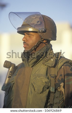 A National Guard member standing guard after the Los Angeles earthquake on January 17, 1994 - stock photo