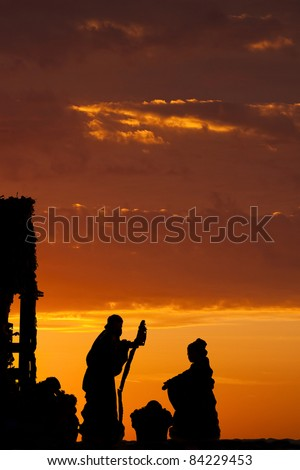 A nativity scene set against a dramatic sunrise - stock photo