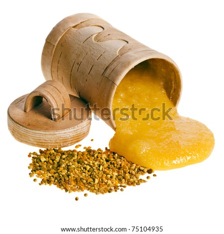 a natural honey and bee pollen isolated on white background