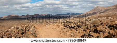 A nature trail in a beautiful volcanic landscape between Yaiza and Las Brenas in southern Lanzarote, Canary Islands, Spain